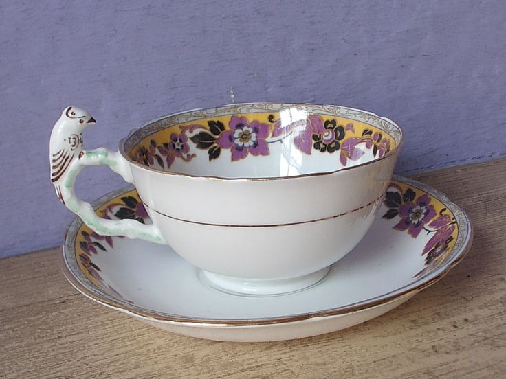 https://www.ebay.com/itm/Antique-England-parrot-bird-handle-purple-yellow-black-bone-china-Tea-cup-teacup/173190366943?hash=item2852f346df:g:mpcAAOSwDrNZRTlg