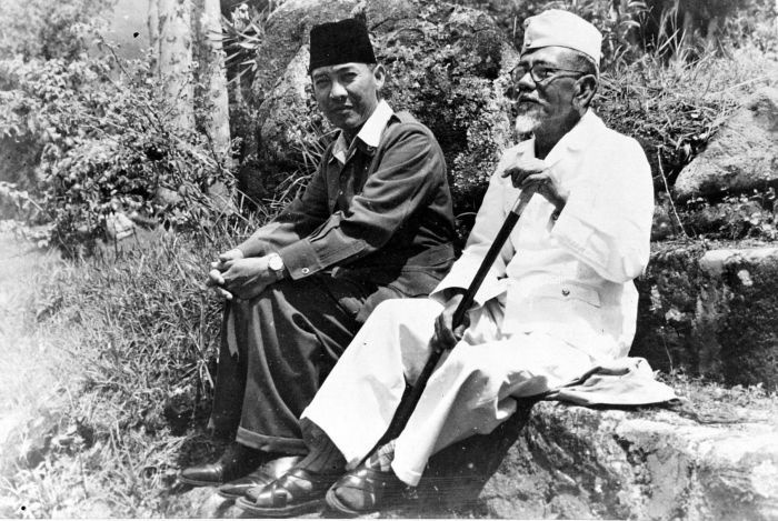 Sukarno and Foreign Minister Agus Salim in Dutch custody, 1949 - Sukarno was first exposed to nationalist ideas while living under Tjokroaminoto. Later, while a student in Bandung, he immersed himself in Western, communist, and Islamic political philosophy, eventually developing his own political ideology of Indonesian-style socialist self-sufficiency.