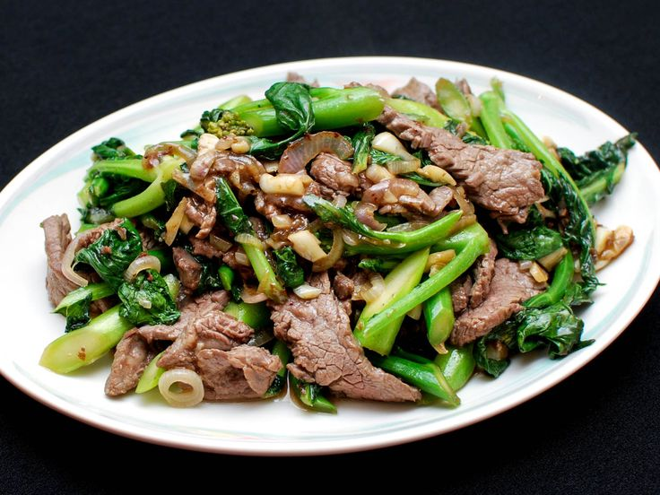 Beef with broccoli is a staple of North American Chinese fast food joints, but the real version of this dish uses Chinese broccoli (gai lan), not the more familiar broccoli florets. Gai lan pairs perfectly with the strips of marinated beef, shallots, garlic, and oyster sauce in this easy dish.