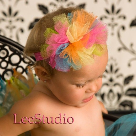 Now that I have a baby girl, I need me a Rainbow tulle bow headband.