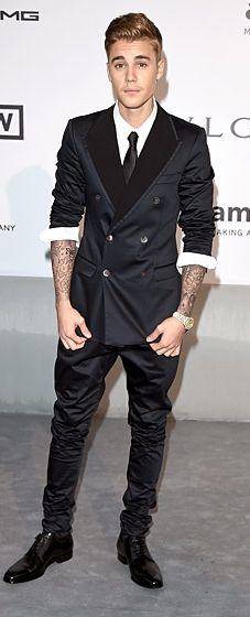 Justin Bieber cleans up well in a Dolce & Gabbana suit in the amfAR Cinema Against AIDS Gala at the Cannes Film Festival