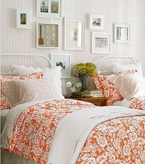 Guest Room. pictures on the walls, colorful bedspreads.