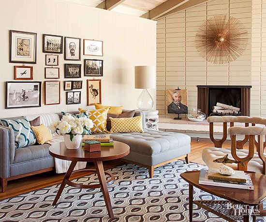 Style: Modern Large bricks laid in a straight-stacked pattern project a retro vibe, as does the sunburst sculpture, while a coat of warm sand-hue paint updates the fireplace design in this charming vintage-meets-midcentury living room.