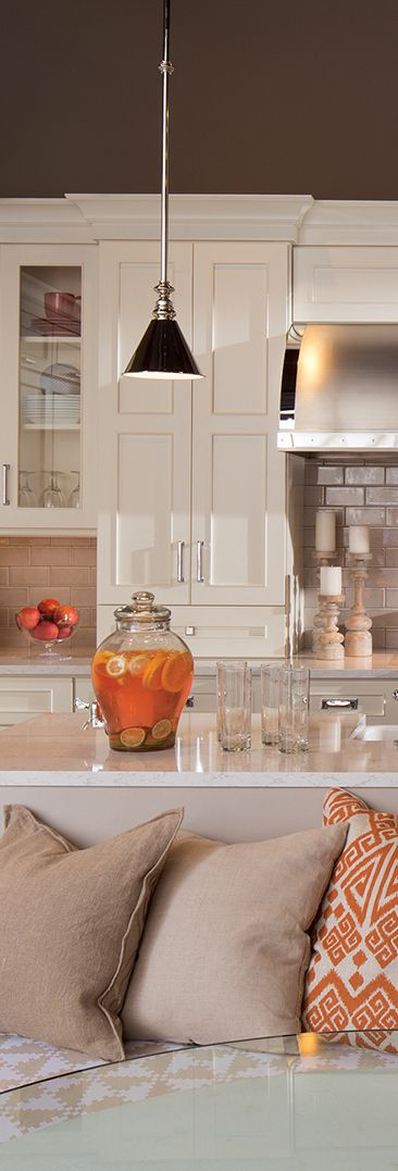 Bright Kitchen Design - Orange and White theme featuring White Cabinetry, Gray Walls, White counters, and Orange Decor - Dura Supreme Cabinetry (Designed by Mingle)