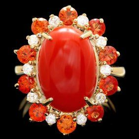 14k Yellow Gold, 8.00ct Coral, Ten Mine Cut Diamond's & Ten Natural Red Sapphires  Ring. Picked this piece because you see red sapphires less often than the blue, white, yellow, black or pink varieties.