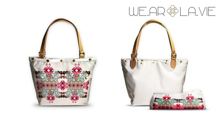 -Wear and Live Life- With Digital collages, inspired by nature, art and architecture, the '' WE.ARLA.VIE'' bags have variety of colours on their outfit printed fabrics, which can be changed very fast and easy. Each white bag can be worn with or without the extra fabric.  Don't change your bag. Change its outfit.