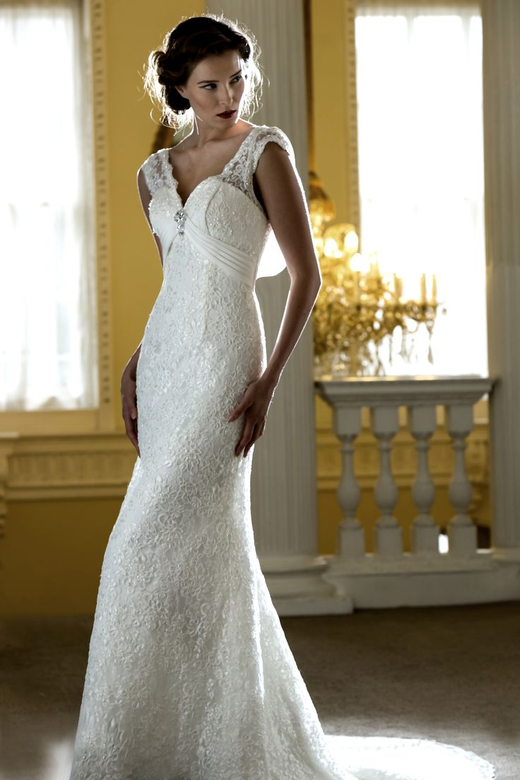 New Nicki Flynn Calla Elegant slim fitting lace bridal gown with deep sweetheart neckline and beaded