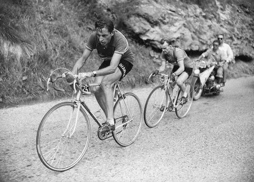 Fausto Coppi climbing Alpe d'Huez ahead of Jean Robic, 1952 Tour de France, the first time the Alpe featured in the Tour.