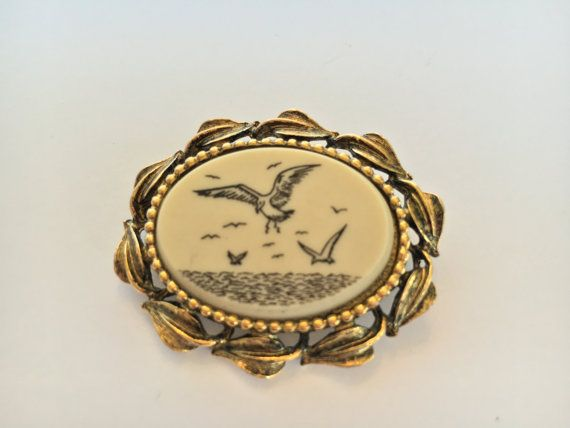 1980s Faux Scrimshaw and Brass Brooch depicting seagulls flying over the water