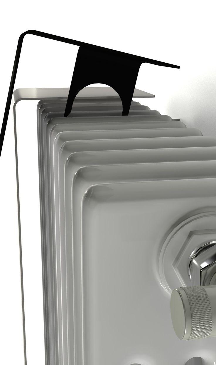 Een blad ultra-dunne stalen dekt de oude buisvormige radiatoren