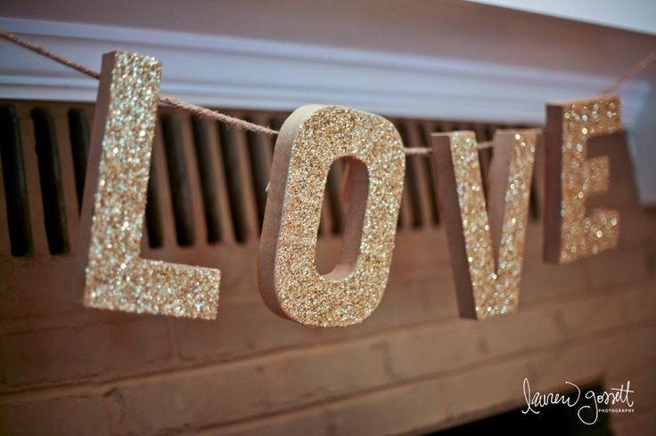 For the LOVE banner we got cardboard letters from a craft store, covered them with glitter, glued clothespins to the back and hung them on some twine from the mantle…