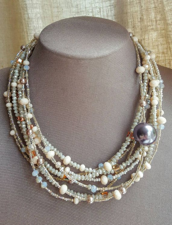 Check out this item in my Etsy shop https://www.etsy.com/ca/listing/466527629/crystal-and-glass-bead-multistrand