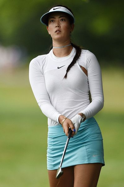 Michelle Wie Photos Photos - Michelle Wie hits her approach shot on the 11th hole during the first round of the Meijer LPGA Classic at Blythefield Country Club on June 15, 2017 in Grand Rapids, Michigan. - Meijer LPGA Classic - Round One