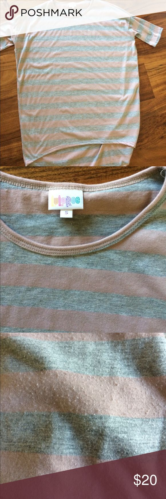 LuLaRoe Irma S LuLaRoe Irma in size S. Size down two times from your usual top size. This is a mauve/blush and light grey stripe. Gorgeous even with jeans!! Worn and washed per LLR instructions but has some pilling. See last pic. A sweater stone or sweater shaver should take care of the pills if it bothers you. (Soft material gets pills) LuLaRoe Tops Tunics