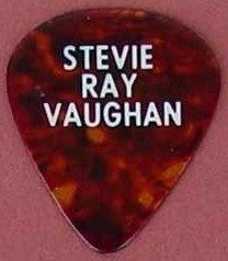 One of many SRV guitar picks used until his passing. The collector says its a medium. However people who knew him said he also used heavy or stiff picks...