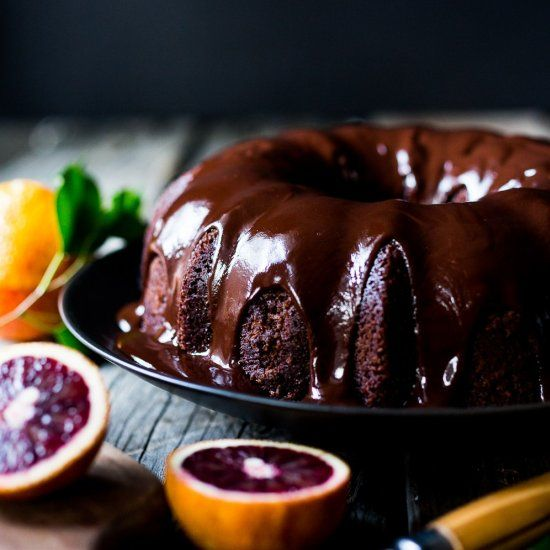 Dark Chocolate Blood Orange Bundt Cake  drizzled with chocolate ganache icing. Moist and delicious, easy recipe. Perfect for Valentines