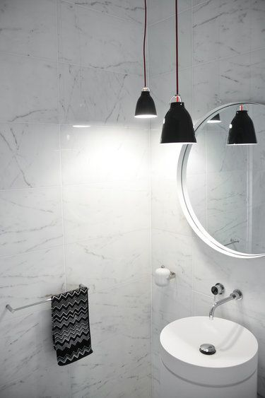 Hey look isn't that kind of like our sink but in white? And I always love Missoni towels. Powder room? Also those hanging pendants the colored ones from before