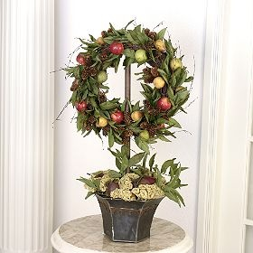 Wreath topiary with a hook that you can change out the wreath for all seasons...???