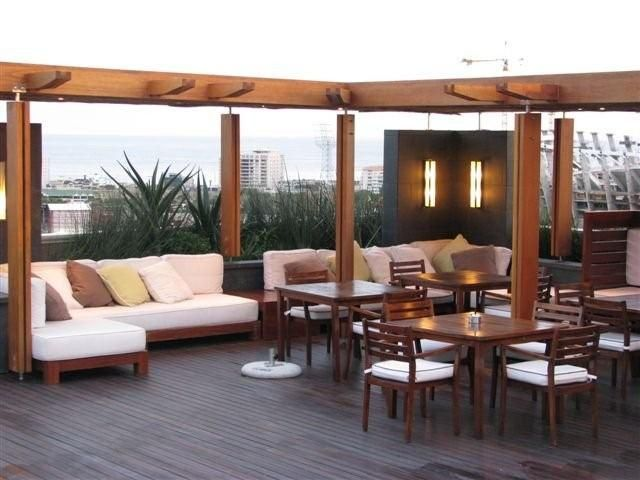 Roof terrace with pool and lounge at Cape Royale in Green Point