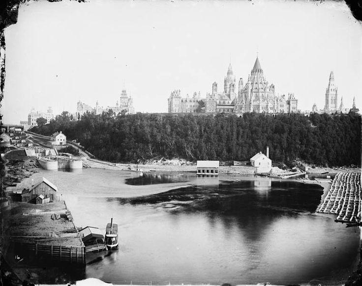 Ottawa.  History.  Parliament, log boom, Rideau Canal.  Ottawa River Timber Trade.  (760×603) MIKAN no. 3241576