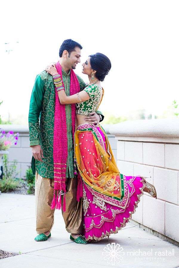 Colorful indian wedding outfits by couple ..