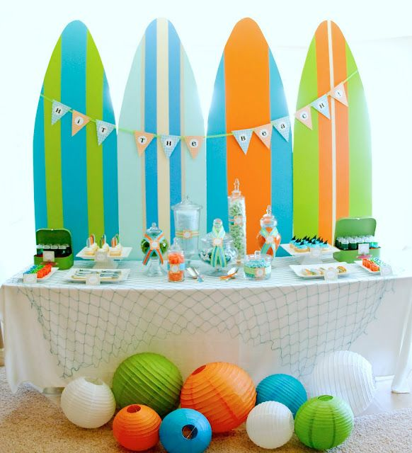 Pool party. This is a great pool party buffet table design. the surf boards and lanterns brings it all out!  THAT WOULD MAKE A SUPER CUTE HEADBOARD FOR THE BOYS' BEDS TOO!!!!