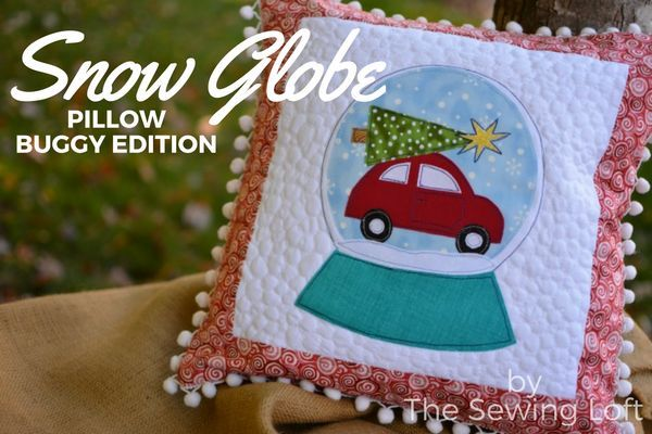 This festive snow globe inspired DIY applique pillow is the perfect addition to any holiday decor.