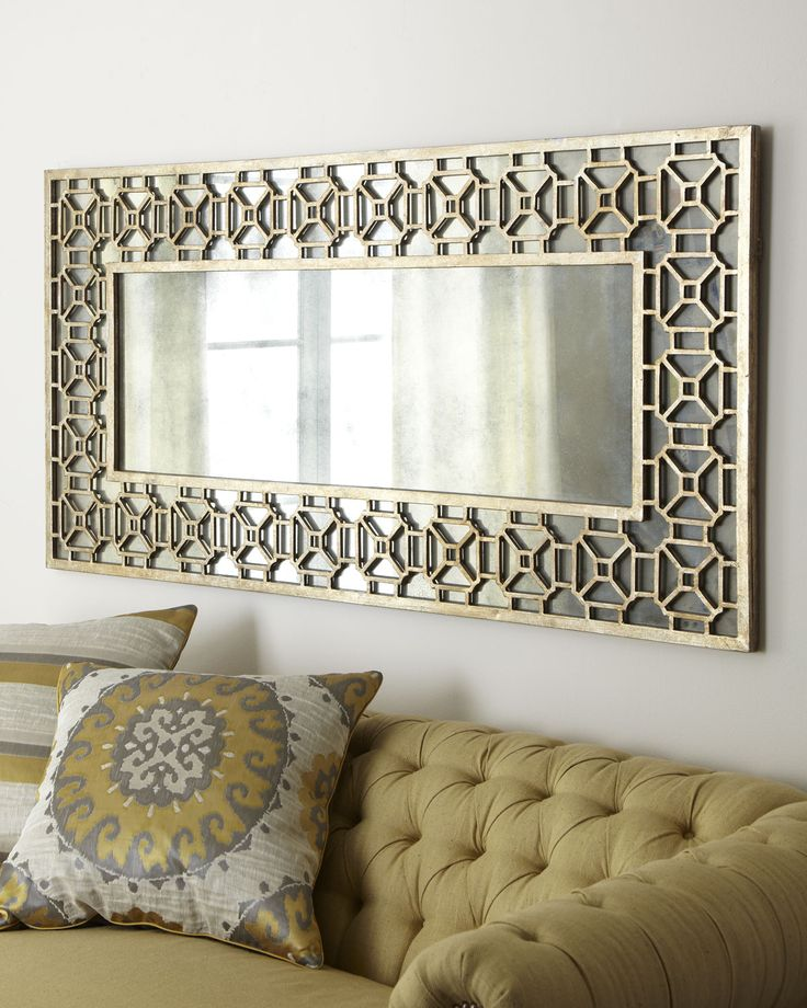 could recreate this look with an inexpensive framed mirror and some stenciling