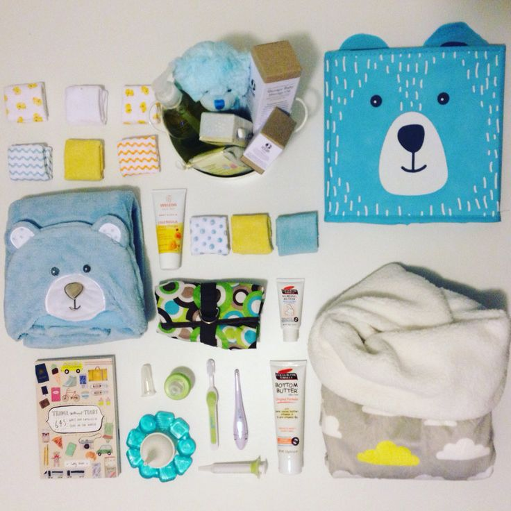 Baby flat lay, baby bo, practical gifts, baby products, delightful baskets, blankets travel kit.