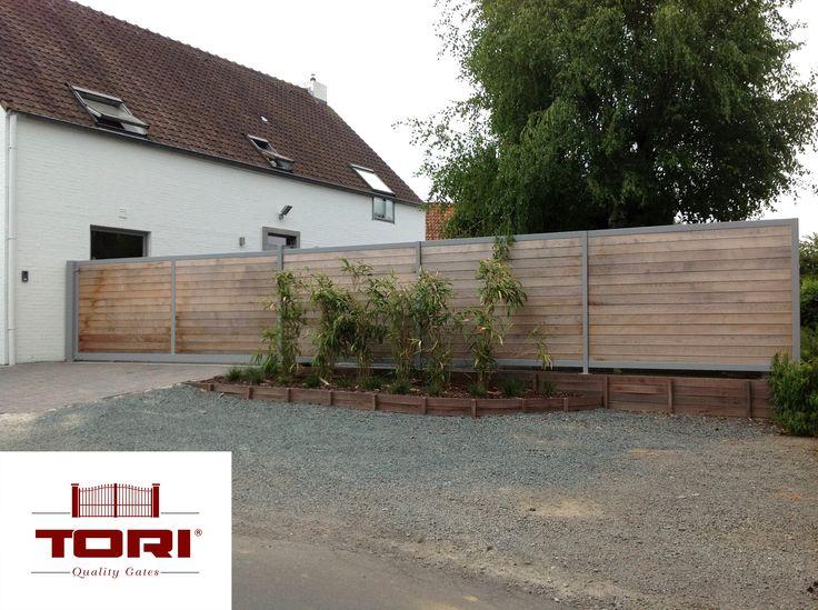 Portail coulissant acier et bois avec palissades www for Portail de jardin coulissant