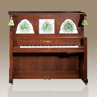 Peerless Arts & Crafts Style Nickelodeon Player Piano (1911)--  Elegant Peerless player piano with beautiful craftsman style art glass and lamps. Those lamps and that glass are too cool.