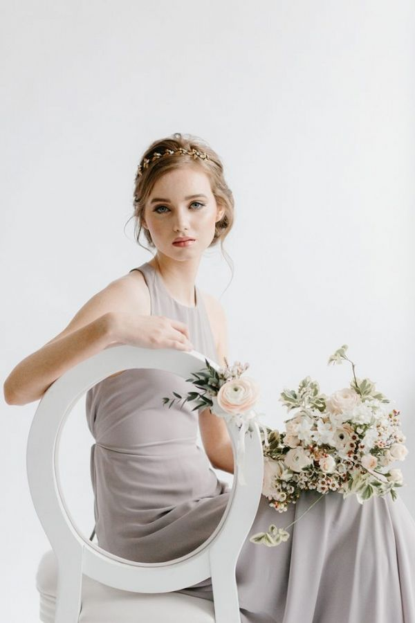 Bridesmaid seated on a white chair holding a bouquet of flowers | Rebecca Goddard Photography on @blovedblog via @aislesociety