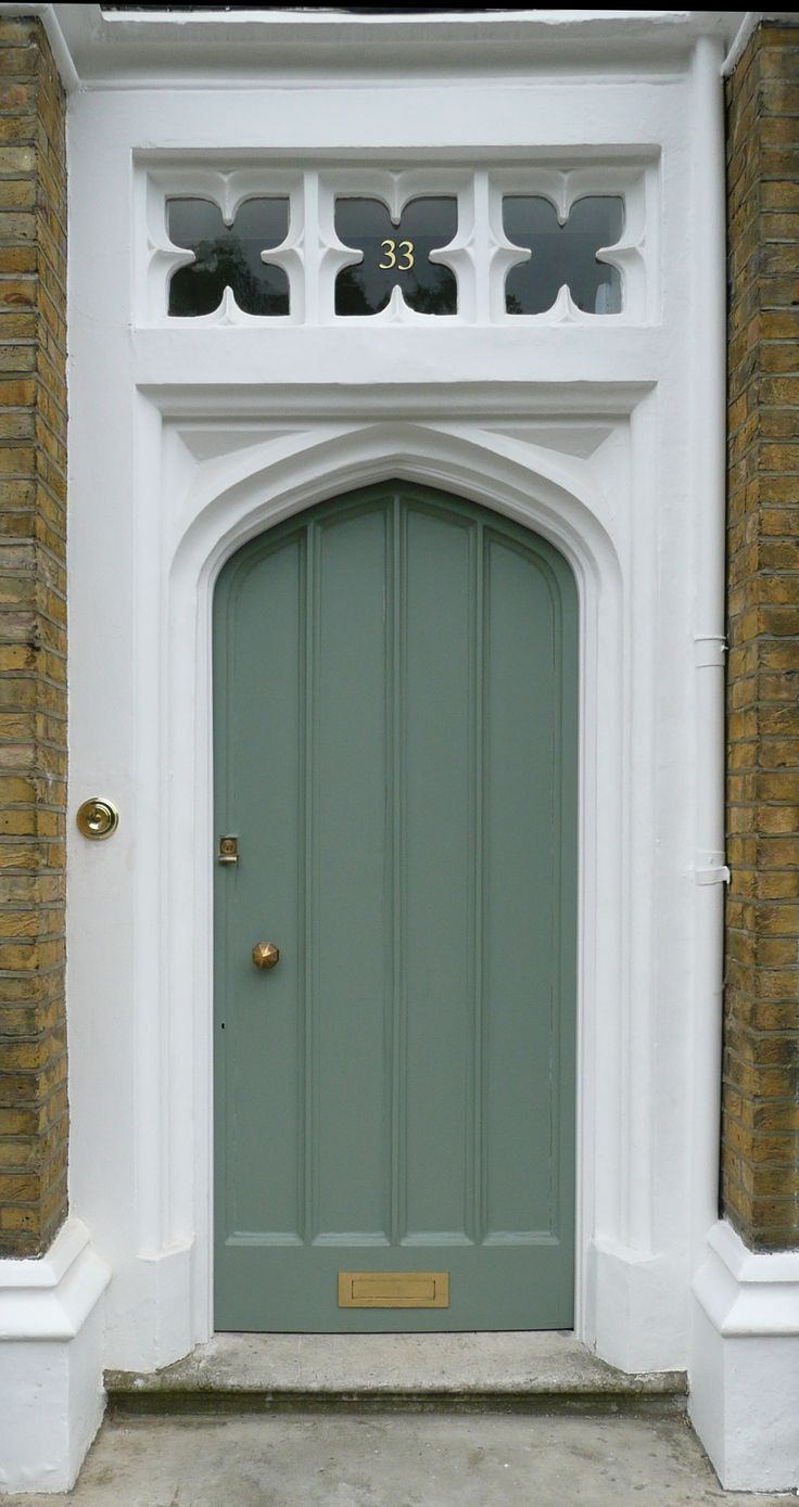 Love the little windows above the door.   A front door in an Islington Square, London, England.