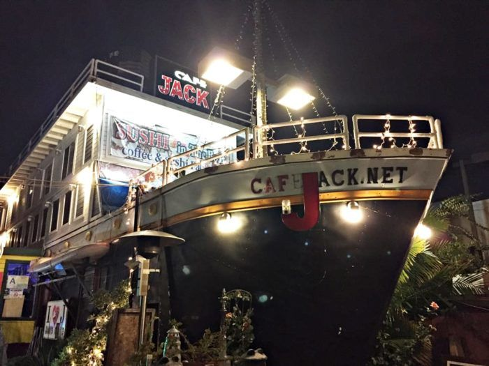 At night, Cafe Jack takes on a dramatic look with its beaming ship lights all aglow.