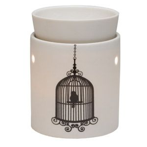 A happy little bird perched in an ornate cage stands ready to greet you in. To purchase, go to www.jenni.scentsy.com.au