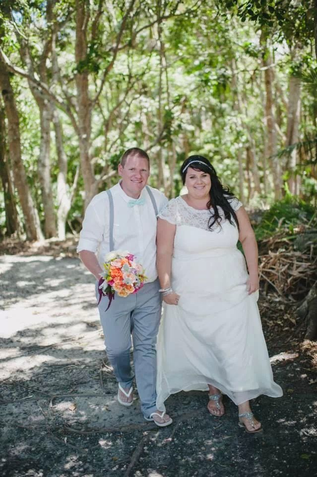 Bride and Groom. Grey Suit. Lace invisible neckline wedding dress. beach wedding. Custom made wedding dress. Broken Head, Byron Bay NSW, AUS
