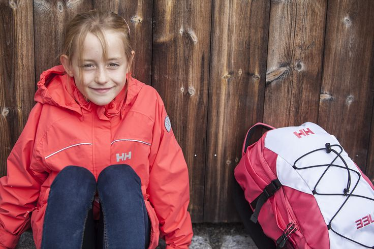 An adorable Helly Hansen girl is all ready to handle any kind of conditions.  Rain coat and pack in hand!  Photo by Preben Stene Larsen