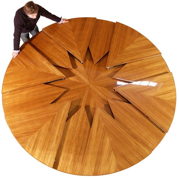 transforming table: The Capstan Table designed by British furniture designer David Fletcher, the table is made on commission for wealthy clients. Each table reportedly cost tens of thousands of pounds. A round table that doubles it's seating capacity, from six to twelve, at the push of a button. Available in manually- and servomechanically-actuated versions.
