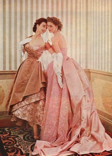 Dorian Leigh and her sister Suzy Parker - I wish it was ok to wear a dress like this for dinner parties still. I need to figure out how to make this work for me. :)