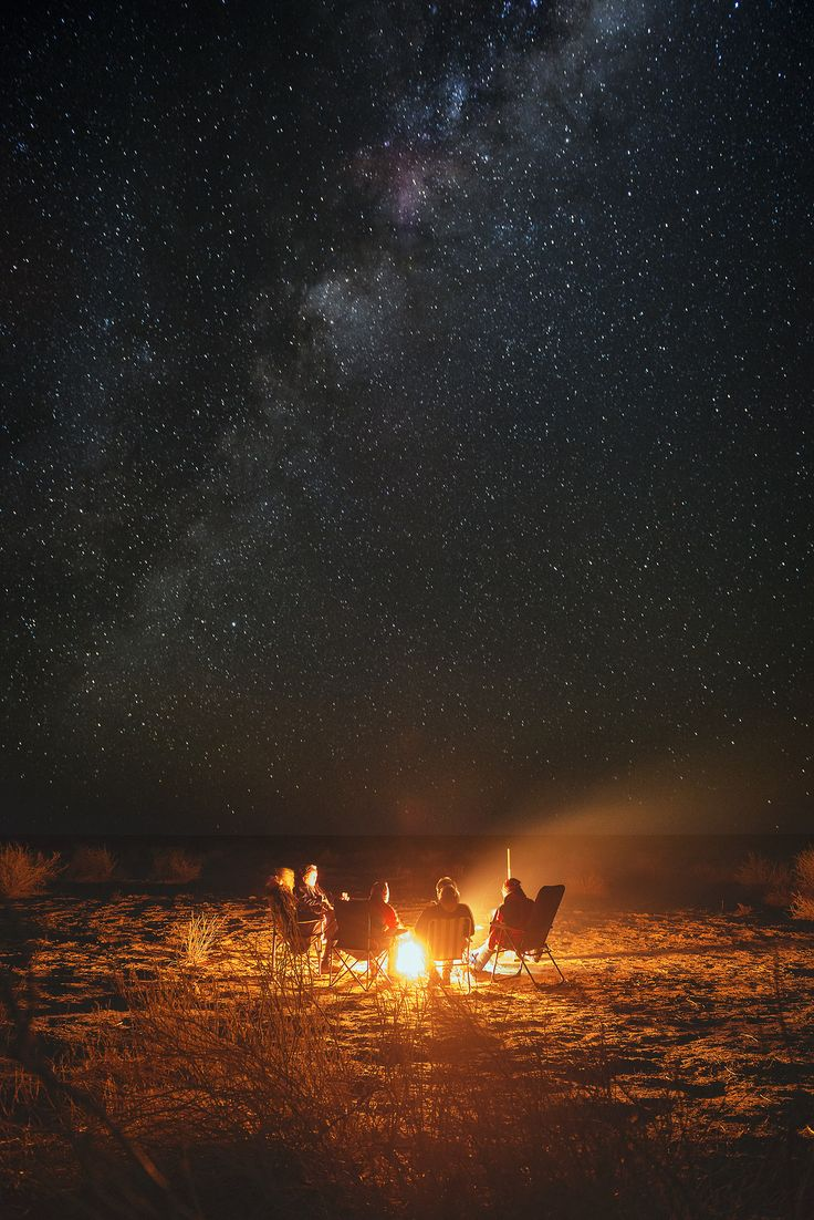 A star filled night with rambling conversations around a crackling campfire.