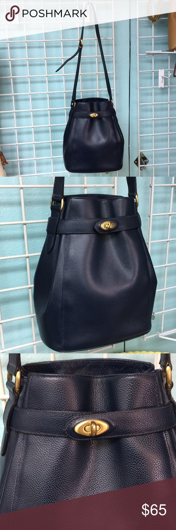Vintage Coach Navy Purse This bag is gorgeous and in excellent condition. It is a navy blue bag with gold feet. So unique and they don't make them like this anymore. It has adjustable straps. Cute!!  My prices are very fair so no trades or lowball offers please. Coach Bags