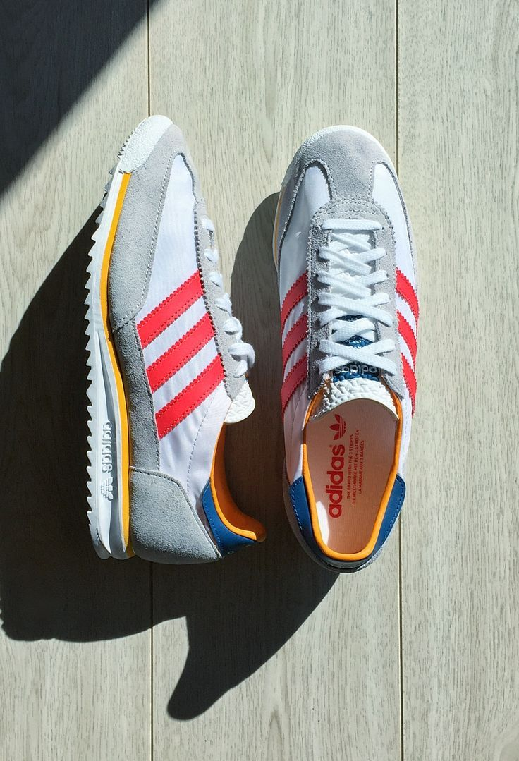 grey adidas trainers with red stripes