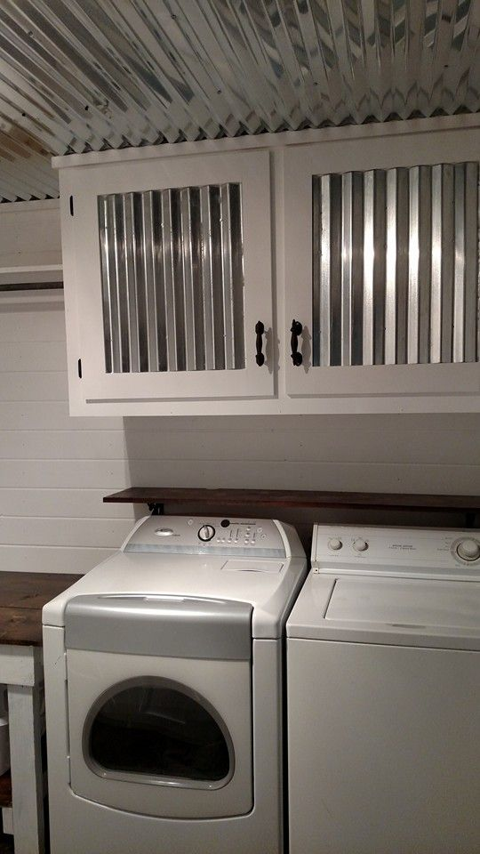 March 2016.  Laundry Room after.  Corrugated tin ceiling and tin in cabinet doors.