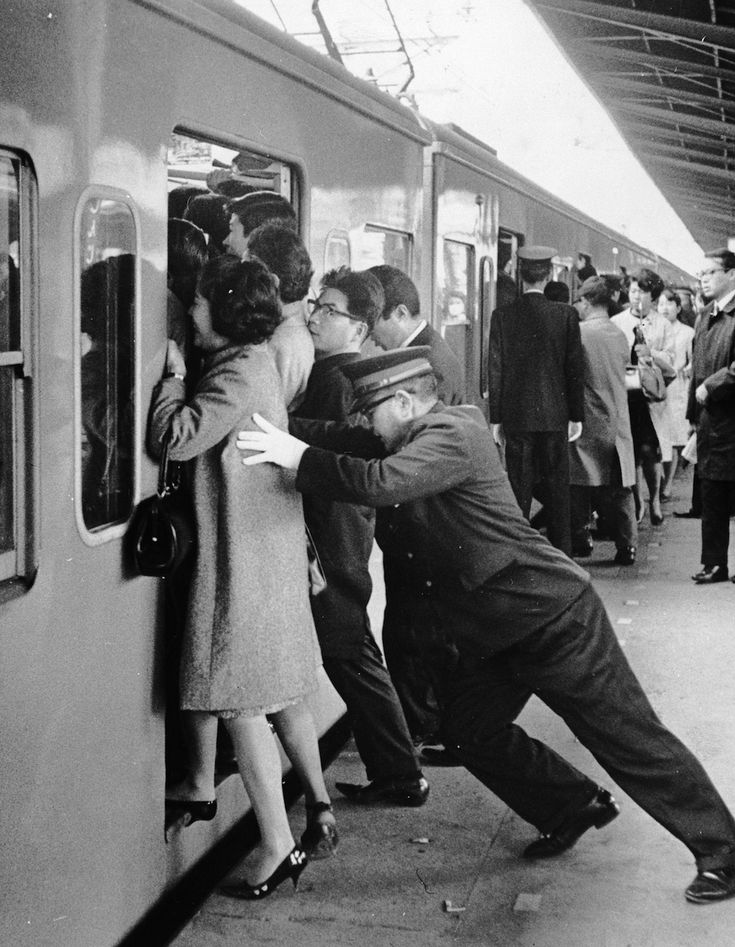 Not sure which is worse — being the pusher or pushee? | Insane Photos Of Tokyo Commuters In The '60s And '70s