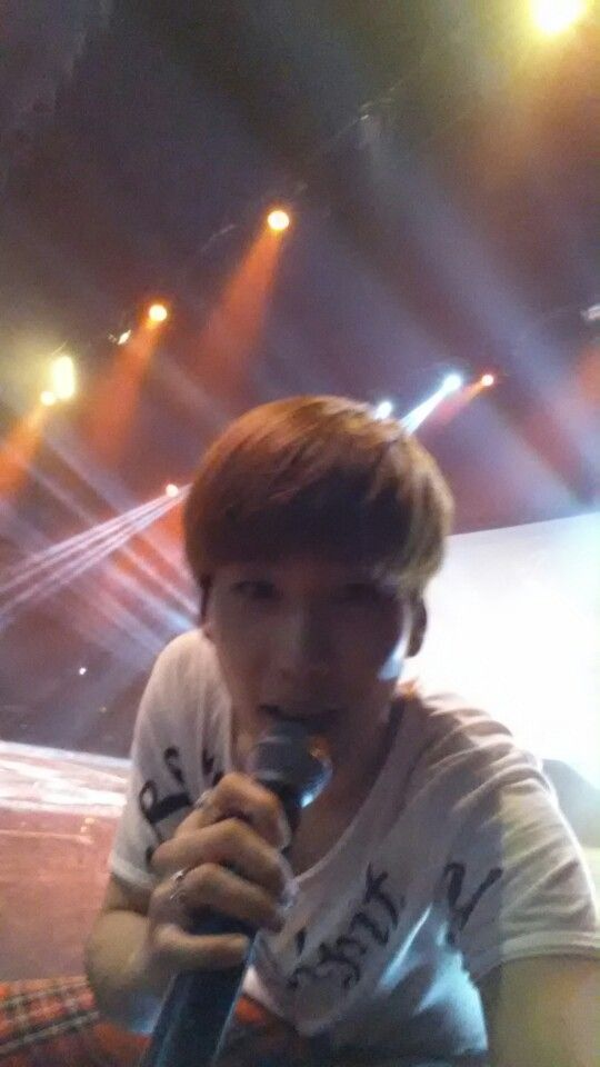 Hyunseong taking a selca with my phone on stage!