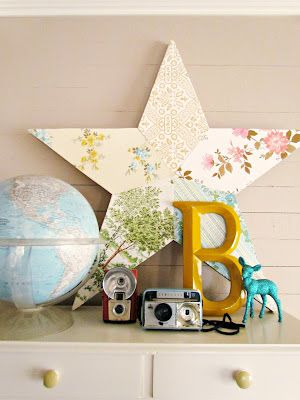 very cute star covered in different patterns of scrapbook paper. i love this and want to make one for my kitchen to hang on the wall