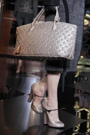 Louis Vuitton - the shoes are to die for.  Or at least I'd give up an elbow for them.