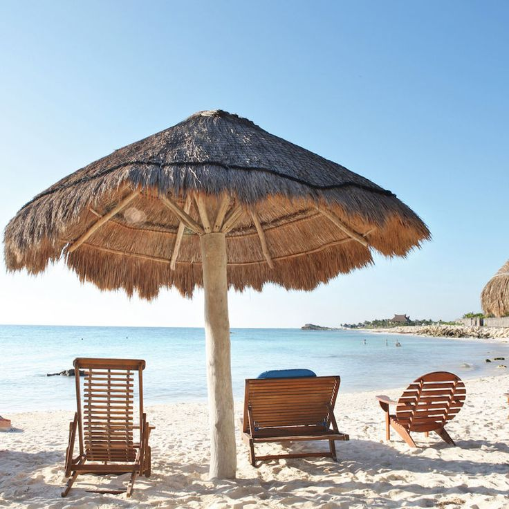 Shambala Petit Hotel Tulum, Mexico Beach Beachfront Island Trip Ideas chair sky umbrella ground Sea hut wooden Ocean lawn fashion accessory Resort Coast set Boat shore day sandy shade