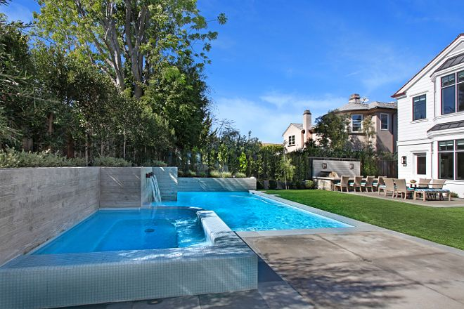 Pool and spa. The custom pool features stamped wood concrete walls. #pool #poolwall Patterson Custom Homes. Interiors by Trish Steele of Churchill Design.