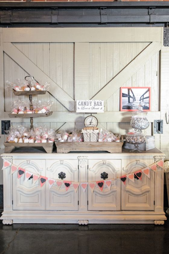 antique white buffet, rustic wedding candy buffet, pink bunting (Love the rustic doors for backdrops!!)